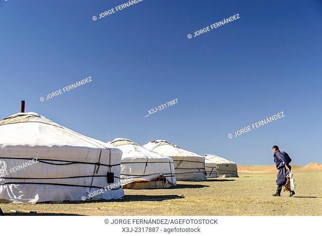 Mongolian man returning home after work, Gobi desert, Mongolia