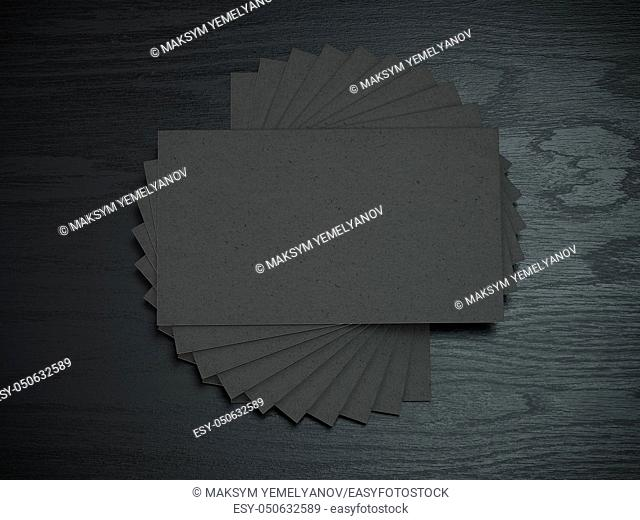 Black blank business cards mockup template on the black wooden table. 3d illustration