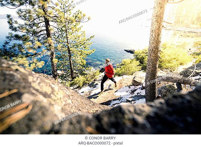 Man Running On Trail Near Lake Tahoe Emerald Bay