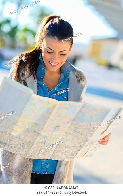 Beautiful Woman Looking In Map