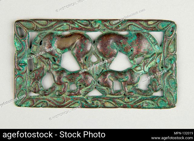 Belt Buckle with Kulans Attacked by Wolves. Date: 3rd-2nd century B.C; Culture: Southern Siberia; Medium: Bronze; Dimensions: H. 3 1/4 in. (8.3 cm); W