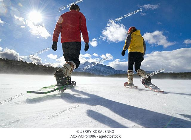 Two snowshoers, Two Jack Lake, Banff National Park, Alberta, Canada