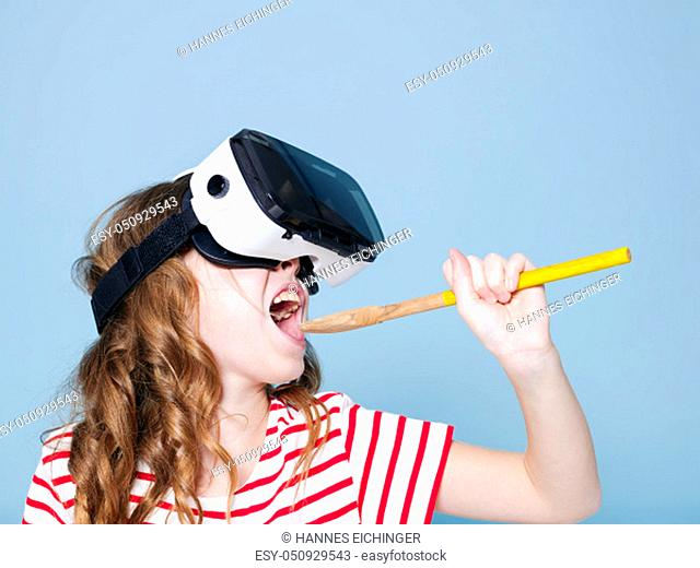 cool and smiling positive girl wearing virtual reality glasses goggles headset is singing with cooking spoon, new generation