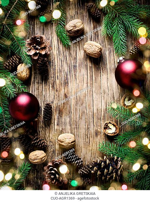 Christmas holiday background with fir branches, pine cones and nuts. Winter holiday concept composition, copy space