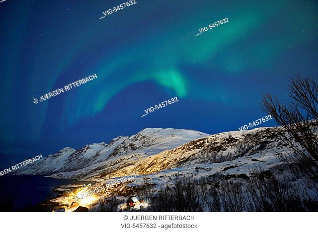 NORWAY, TROMSOE, 24.02.2016, Aurora Borealis or northern lights over winter landscape in fjord of Ersfjordbotn, Tromsö, Troms, Norway, Europe - Tromsoe, Troms