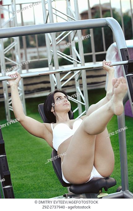 Young Woman In Underwear Doing Heavy Weight Exercise For With Barbell