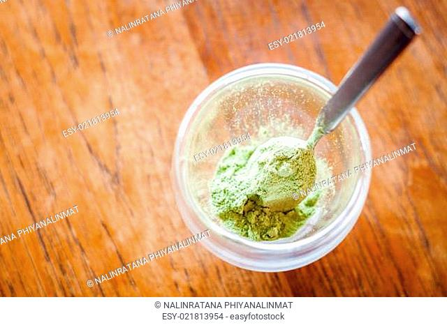 Green tea powder in glass