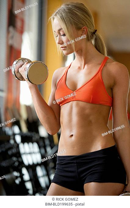 Caucasian woman exercising with dumbbells