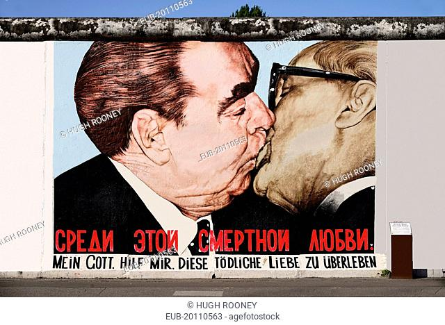 The East Side Gallery a 1.3 km long section of the Berlin Wall Mural called My God help me survive this deadly love Soviet Premier Brezhnev kisses East German...