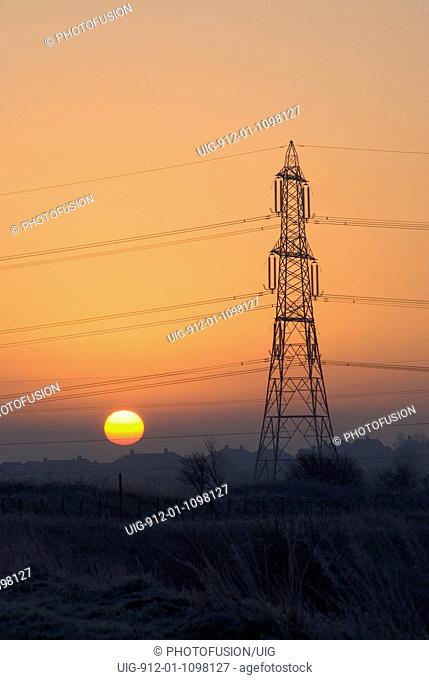 Pylons carrying power lines across Frodsham Marshes in Cheshire. Frosty morning February 2007 UK