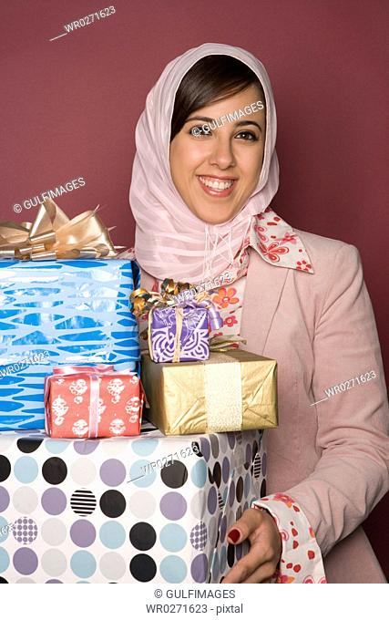Young woman holding gift box,portrait