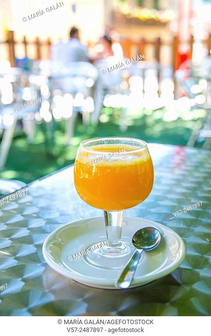 Glass of orange juice in a terrace