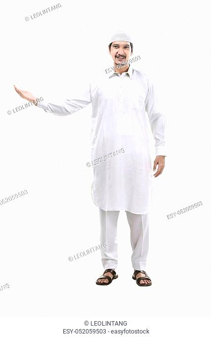Handsome muslim man show something isolated over white background