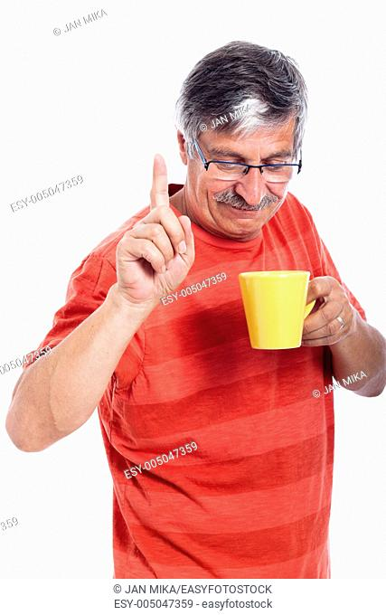 Senior man holding mug and gesturing, isolated on white background