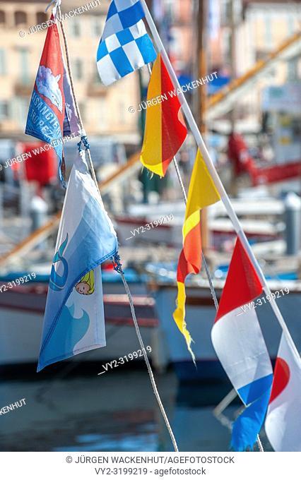 Flags in the fishing harbor, Saint-Tropez, Var, Provence-Alpes-Cote d`Azur, France, Europe