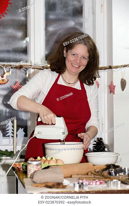 woman is baking cookie