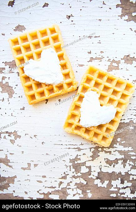 Very beautiful Belgian waffles on an old table