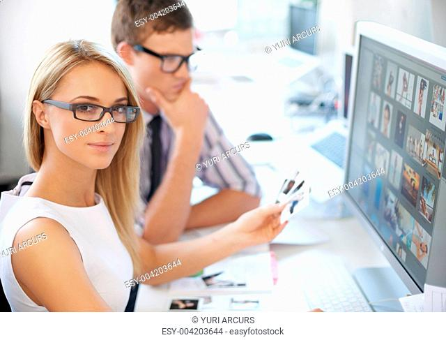 Young designers going over some images together while at work