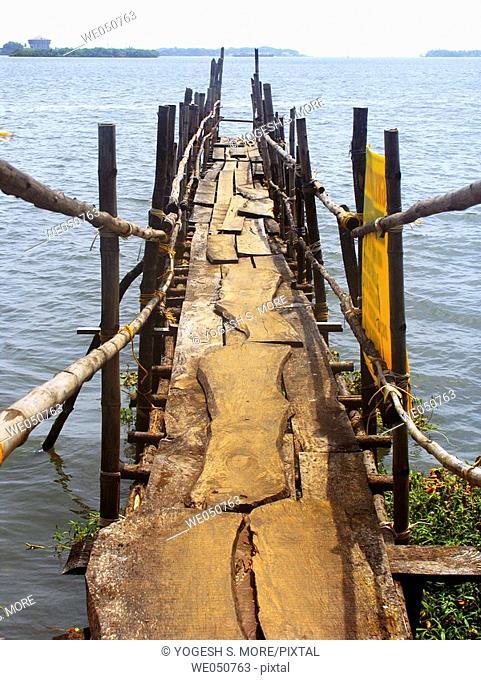 A wooden Landing stage (bridge) for Ferryboats leading towards a Dock. Ernakulam (Cochin) Kerala, India