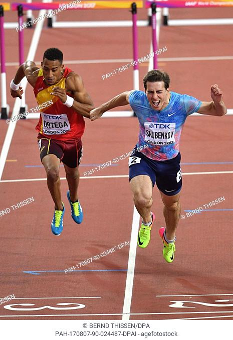 Russian athlete Sergey Shubenkov (R) finishes in second place in the men's 110 meter hurdle event at the IAAF London 2017 World Athletics Championships in...