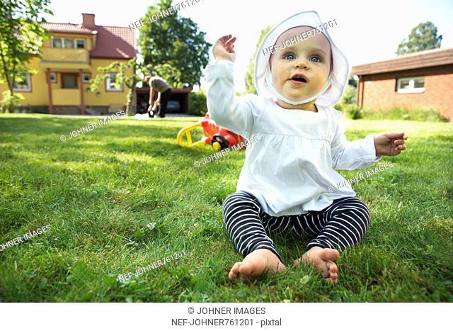 Small child in a garden, Sweden