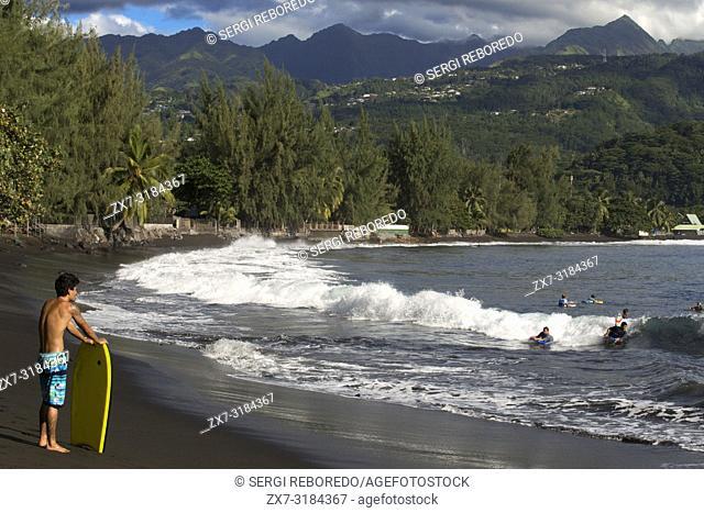 Surfers at Beach with black sand on Pointe Venus, Tahiti, French Polynesia, Tahiti Nui, Society Islands, French Polynesia, South Pacific