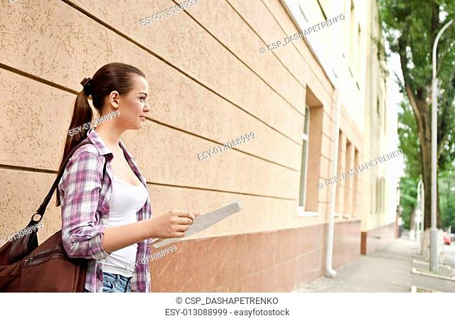 Young brunette girl holding a map