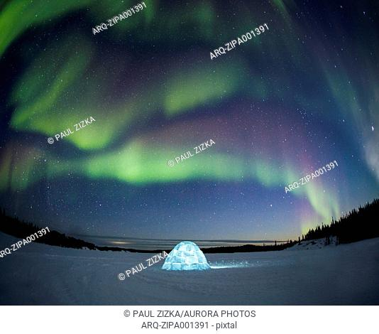 Illuminated Igloo Under Aurora Borealis In Yellowknife