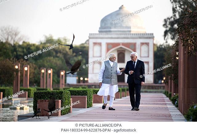 24 March 2018, India, New Delhi: German President Frank-Walter Steinmeier ..(R) Indian Prime Minister Narendra Modi taking a stroll in the Sunder Nursery garden...