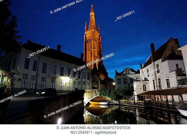 Curch of Our Lady from the Dijver Canal at night. Bruges, Belgium, Europe
