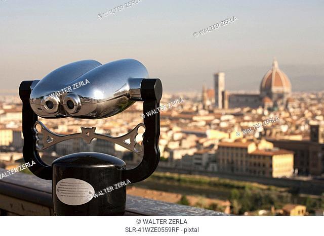Binoculars overlooking cityscape