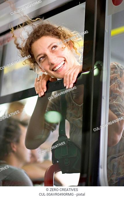 Woman looking out of a bus window