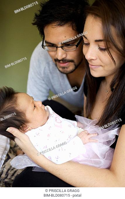 Mother and father looking at newborn baby