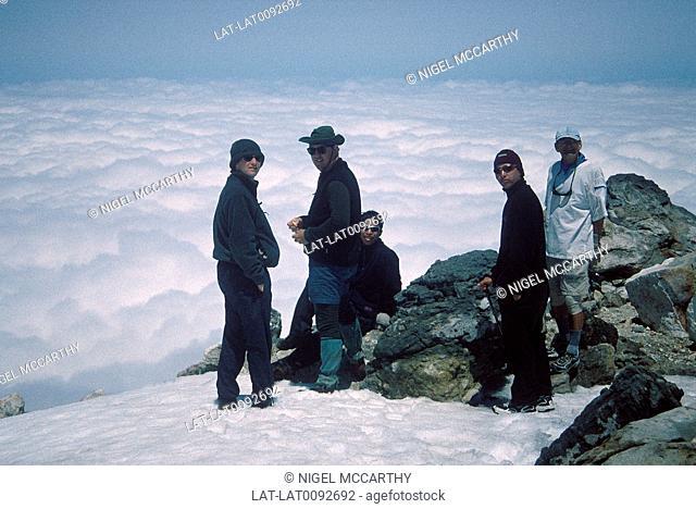 Mount Egmont. National park. Peak,summit. Ice,snow. Group of trekkers,climbers