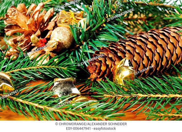 advent season decoration with fir tree branch and fir cone