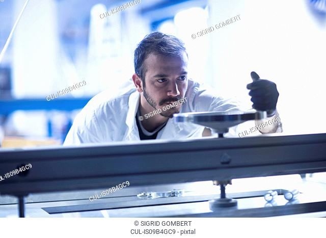 Scientist operating heavy machinery