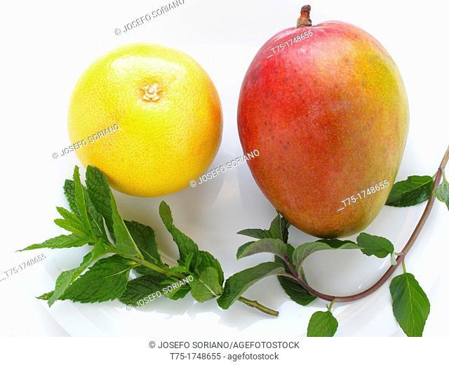 Mango, grapefruit and mint leaves
