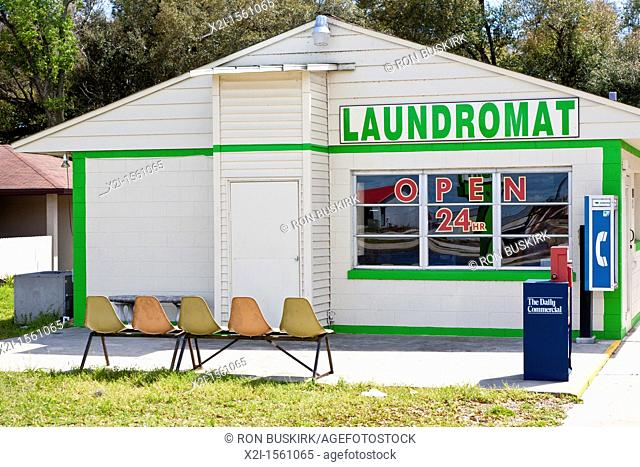 Waiting chairs outside a laundromat in Leesburg, Florida
