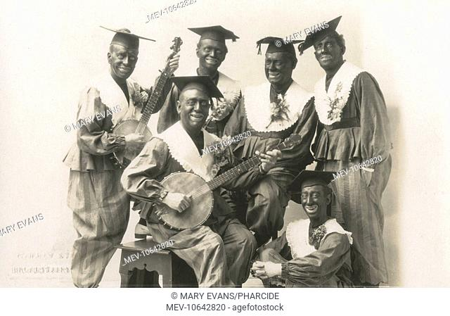 A Blacked-up Minstrel Troupe, with two banjo players and all wearing mortar boards!