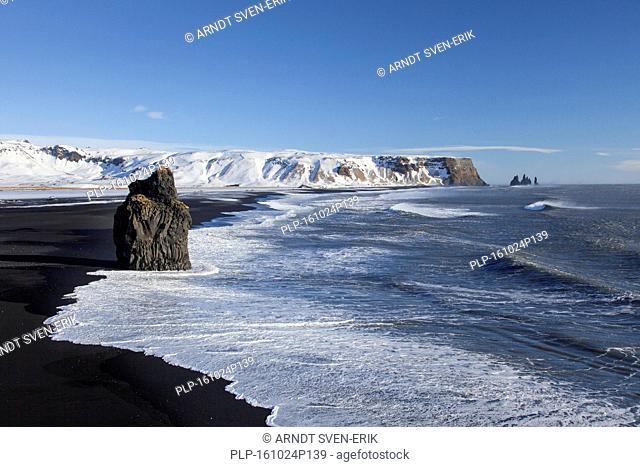 Arnardrangur / Eagle rock, basalt sea stack on the Black sand beach Reynisfjara near Vík í Mýrdal, Iceland