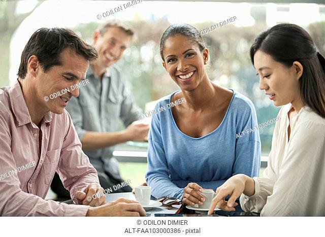 Woman enjoying coffee break with colleagues