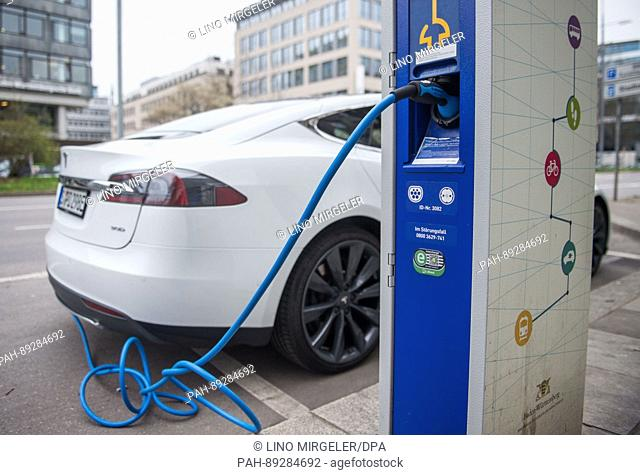 A Tesla S electric car is charged at a power station in Stuttgart, Germany, 24 March 2017. The state of Baden-Wuerttemberg plans 2