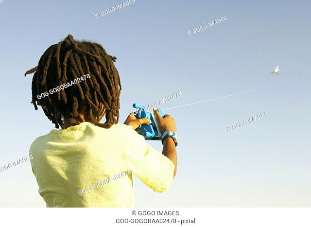Young African child flying a kite