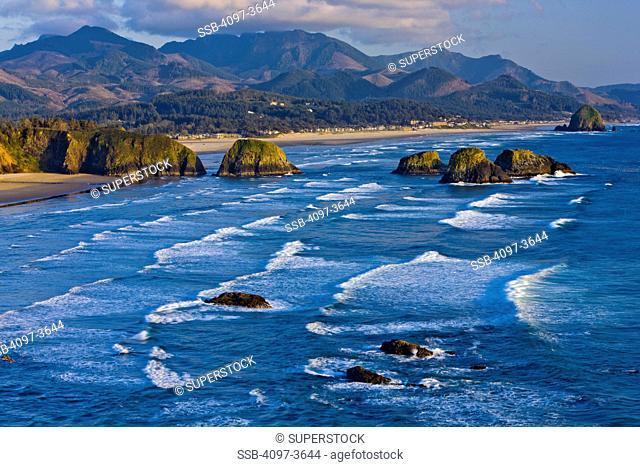 Rock formations in the ocean, Cannon Beach, Oregon Coast, Oregon, USA