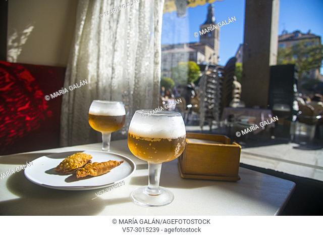 Two glasses of beer and tapa in a cafe. Plaza Mayor, Segovia, Spain