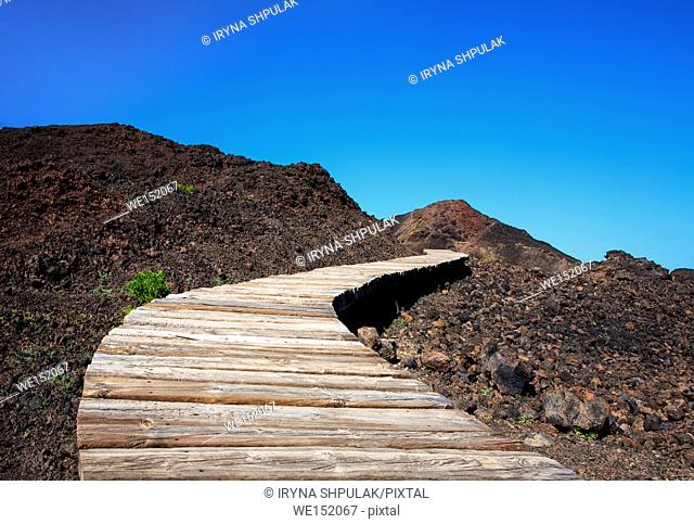 Plank way across volcanic black earth, near Punta de Teno, Island Tenerife, Canary Islands, Spain