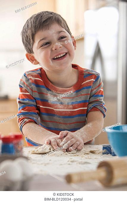 Boy baking in kitchen