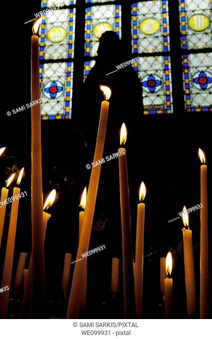 Candles burning inside the Basilica of the Saint Sauveur, Dinan, France