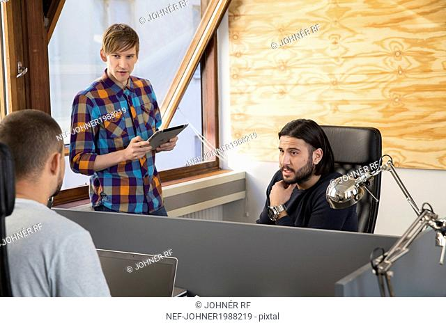 Young men in office