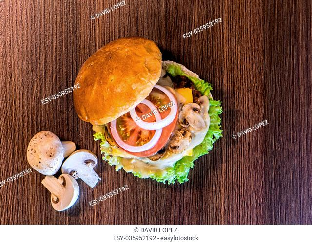Top view of tasty mushrooms hamburger and all its ingredients